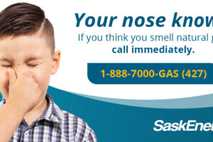 Billboard about what to do if you smell natural gas.